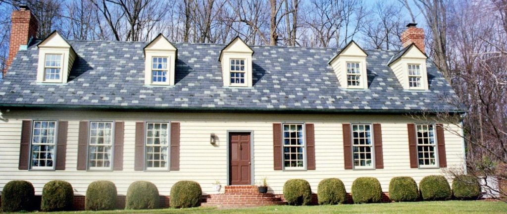 Painted exterior house tan shutters in Germantown Maryland