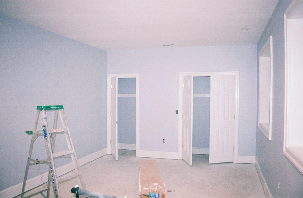 Interior bedroom of house painted blue with white trim