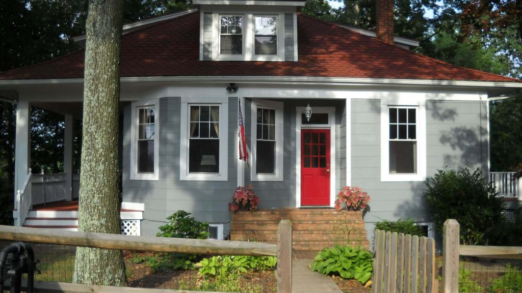 A blue house with a red door.