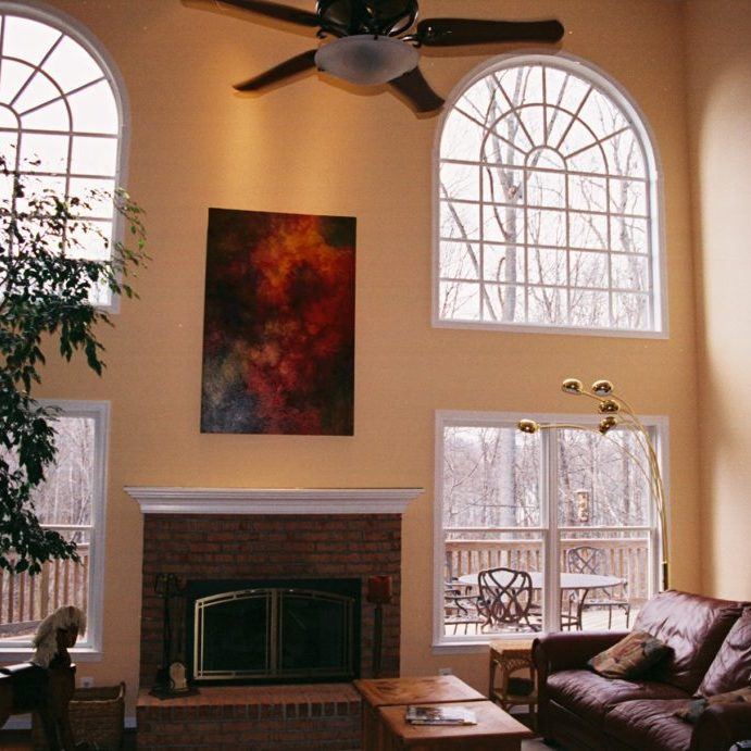 2 story living room painted walls and high ceiling