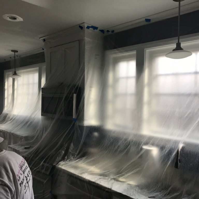 Inside a kitchen covered in plastic.